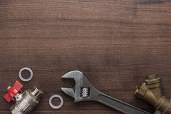Adjustable wrench and pipes Stock Photography