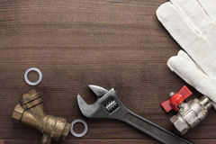 Adjustable wrench and pipes Stock Images