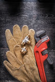 Adjustable wrench plumbing fittings leather safety Royalty Free Stock Photography