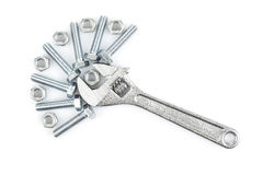 Adjustable wrench with screws and nuts Stock Photography