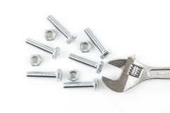 Adjustable wrench with screws and nuts Royalty Free Stock Photos