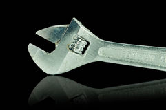 Adjustable Wrench and shadow effect on black Stock Images