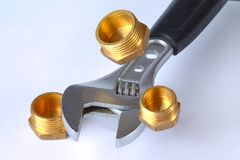 Adjustable wrench with three plugs. stock image