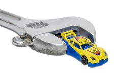 Adjustable wrench and a toy car Stock Image