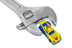 Adjustable wrench and a toy car Stock Photos