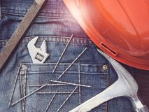 Adjustable wrench, vintage, stylish jeans and nails stock photo
