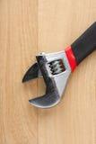 Adjustable Wrench on wood. Adjustable Wrench on a wooden work bench Stock Photos