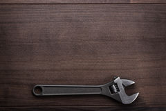 Adjustable wrench on the wooden background Stock Photo