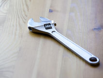 Adjustable wrench on wooden background Stock Image