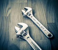 Adjustable Wrenches - Spanners on table Stock Photos