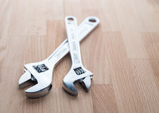 Adjustable Wrenches - Spanners on table Royalty Free Stock Photos