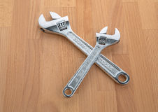 Adjustable Wrenches - Spanners on table Royalty Free Stock Photography