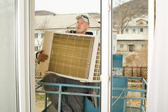 Adjuster sets a new external unit air conditioner Stock Images