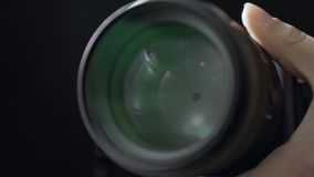Adjusting aperture of camera lens operation close up, concept of photogapher job stock video