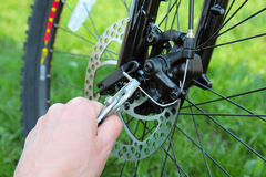 Adjusting Bicycle Gears with Pliers Royalty Free Stock Image