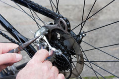 Adjusting Bicycle Gears with Pliers and Key Stock Images