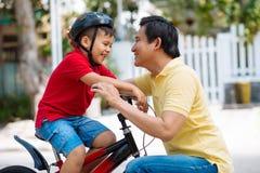 Adjusting bicycle helmet Royalty Free Stock Photo
