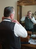 Adjusting the Bowtie. A senior man prepares for his wedding stock photos