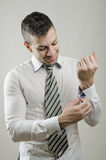 Adjusting cufflinks Stock Photo