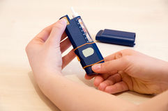 Adjusting dose of insulin. Adjusting insulin dose for injection with pen royalty free stock photos