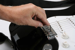 Adjusting electric guitar Stock Image