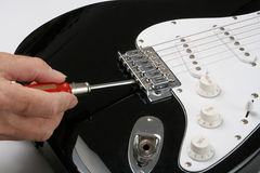 Adjusting electric guitar Stock Photos