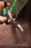 Adjusting garment Royalty Free Stock Photo