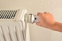 Adjusting heater Stock Photo