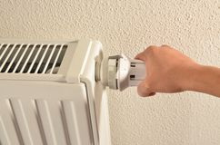 Adjusting heater low Royalty Free Stock Image