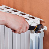 Adjusting heating radiator Stock Images
