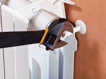 Adjusting heating radiator. Adjustable wrench and adjustment of heating radiator Royalty Free Stock Photography