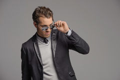 Adjusting his sunglasses. Handsome young adjusting his sunglasse Stock Photos