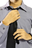 Adjusting Necktie Stock Photography