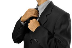 Adjusting Necktie Royalty Free Stock Photos
