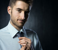 Adjusting necktie Stock Photos