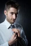 Adjusting necktie Stock Photography