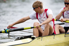 Adjusting oars. BOSBAAN, AMSTERDAM - JULY 23: Markus Holmemo (Norway Lightweight Men's Four, stroke position) adjusts the riggers for his oar prior to the start Royalty Free Stock Photography