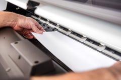 Adjusting paper in printer Royalty Free Stock Images