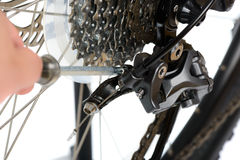 Adjusting rear derailleur Royalty Free Stock Photography