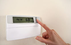 Adjusting and setting thermostat Stock Images