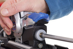 Adjusting ski binding release setting Royalty Free Stock Photos