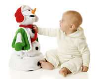 Adjusting the Snowman Scarf Royalty Free Stock Images