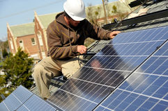 Adjusting Solar Panels 2 Stock Photo