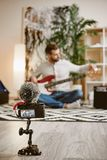 Adjusting a sound. Close up of digital camera screen with male music blogger adjusting electric guitar and recording new. Video for vlog. Youtube channel. Music stock images