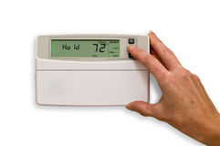 Adjusting thermostat Royalty Free Stock Photos