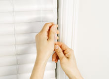Adjusting Windows Blinds with Wand Royalty Free Stock Images