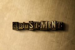 ADJUSTMENT - close-up of grungy vintage typeset word on metal backdrop. Royalty free stock illustration.  Can be used for online banner ads and direct mail Stock Photos