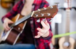 Adjustment of guitar pegs Royalty Free Stock Image