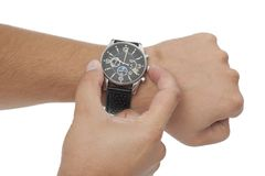 Adjustment of the watch Royalty Free Stock Photography