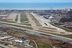 Adler airport. SOCHI, ADLER, RUSSIA - MAR 02, 2014: Runway Adler airport and Black sea, top view stock photo